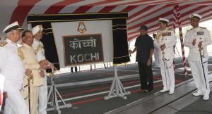 Defence minister Manohar Parrikar unveiling the ships plaque
